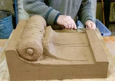 Hand-carved terracotta scroll work will adorn entry. (Wilson Custom Design Tile)
