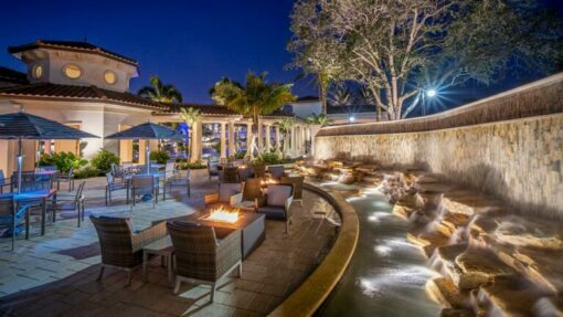 outdoor bistro seating with fire pits and water fountain feature