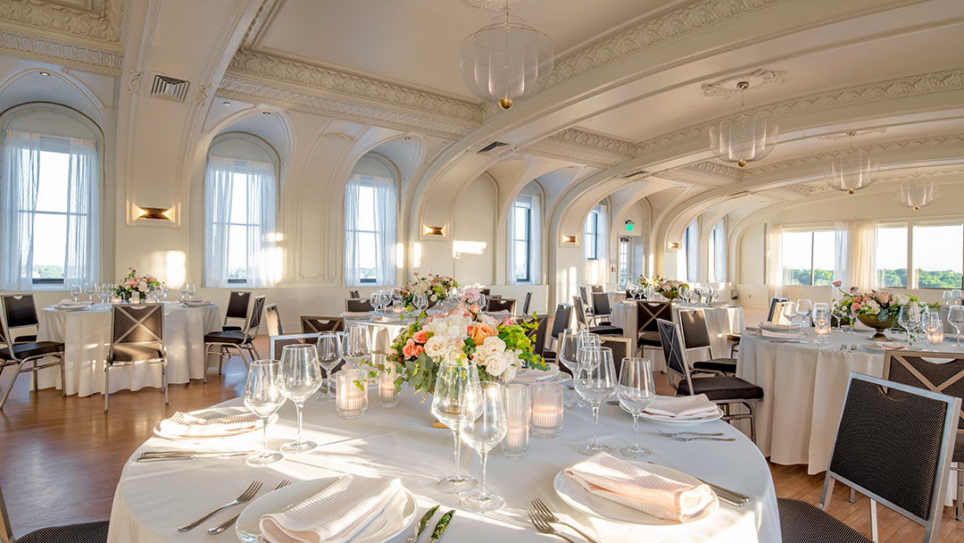 historic ballroom decorated with floral centerpieces