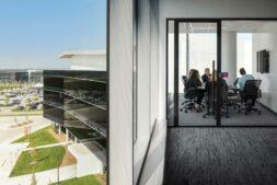 Carson headquarters design meeting behind electrochromic glass