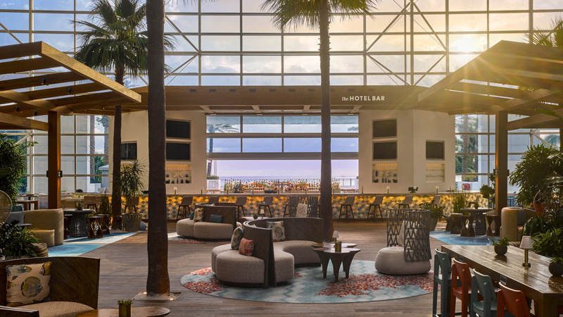 Palm trees, lounge seating and lobby bar at the Diplomat Beach Resort, designed by LEO A DALY