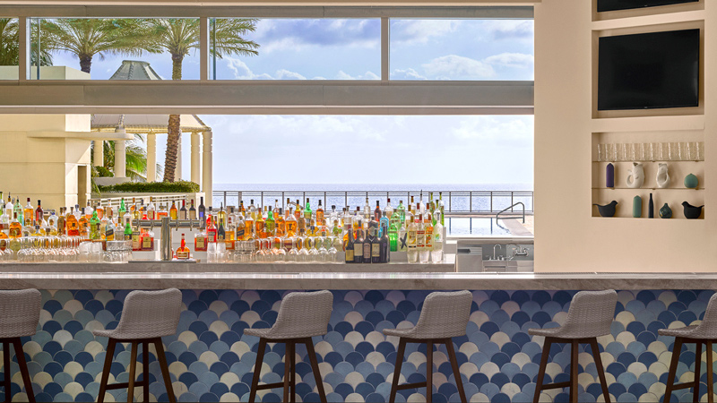 Hotel Bar with beach views at Diplomat Beach Resort, designed by LEO A DALY