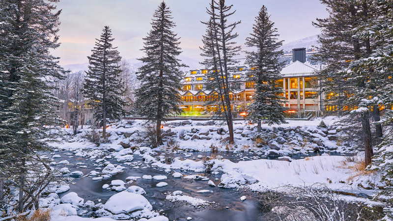 Exterior across Gore Creek at Grand Hyatt Vail hotel, designed by LEO A DALY