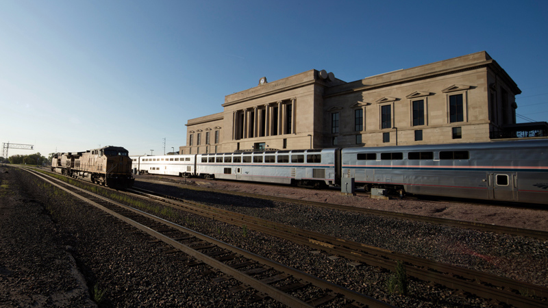 Trains passing behind 7 Burlington Station, designed by LEO A DALY