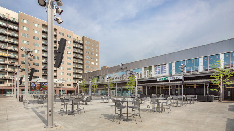 Omaha's Capitol District entertainment district courtyard with retail, apartments and outdoor event space