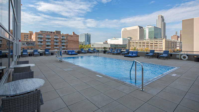 Marriott Downtown Omaha at the Capitol District rooftop pool with skyline views, designed by LEO A DALY