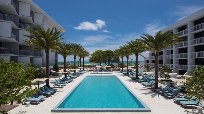 Outdoor pool with beach views at Zota Beach Resort, designed by LEO A DALY