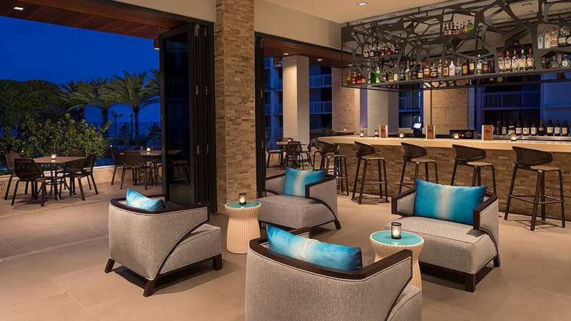 Indoor outdoor bar at Zota Beach Resort, designed by LEO A DALY