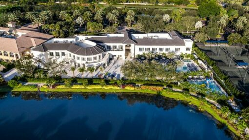 aerial view mizner country club with water and building