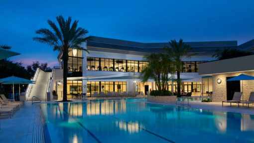 exterior view at dusk pool with new fitness complex