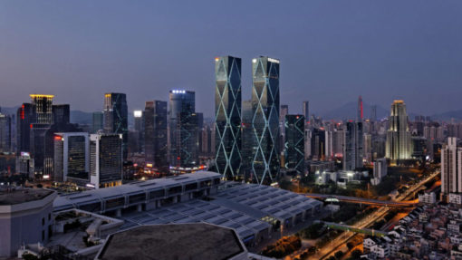 four towers enveloped in glass feature retail restaurant